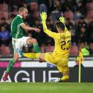 Kept out: Northern Ireland's Liam Boyce tangles with the Czech Republic's Jifi Pavlenka in Prague on Monday evening