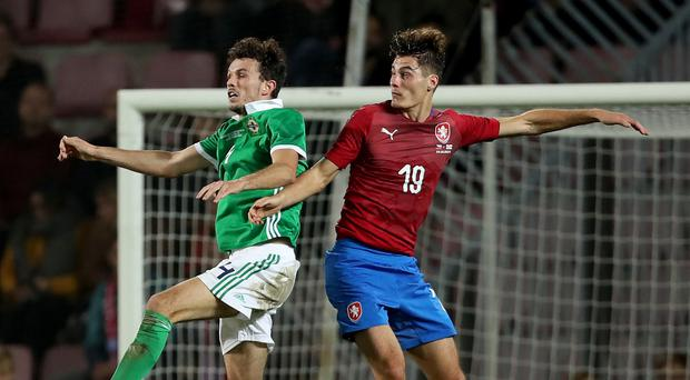 Rising high: Tom Flanagan heads clear under pressure from Czech Republic's Patrik Schick