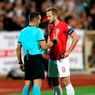 Tough watch: Harry Kane talks to the referee in Sofia
