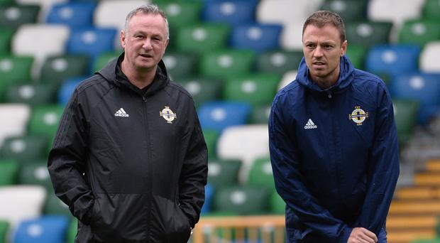 Mutual respect: Michael O'Neill and Jonny Evans in training