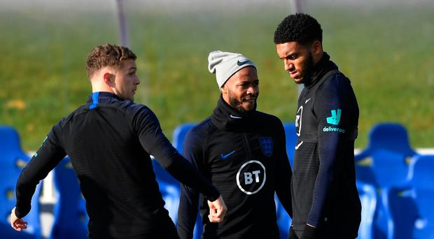 Moving on: Joe Gomez and Raheem Sterling train with the England squad