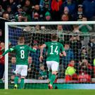 Going over: Steven Davis skies his penalty against the Netherlands