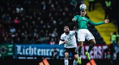 On the up: Josh Magennis climbs high against Germany's Emre Can on Tuesday night