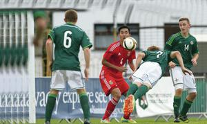 Just what the doc ordered: Josh Doherty heads Northern Ireland in front against China at the Dale Farm Milk Cup