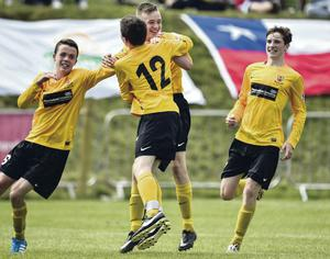 Local heroes: Dylan Davidson celebrates after giving County Antrim the lead in their 4-1 win over Santa Marta de Liray of Chile