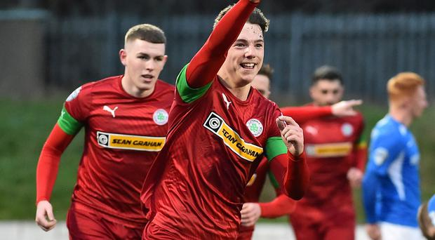 Leading by example: Cliftonville's Thomas Maguire celebrates his winner against Glenavon