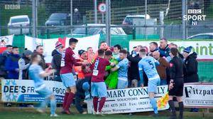 Ugly scenes: Warrenpoint goalkeeper Mark Byrne clashed with Ballymena supporters