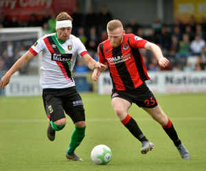 Full flight: Ross Clarke takes on Glentoran's Robbie McDaid