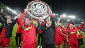 Late sting: Cliftonville's Joe Gormley and Chris Curran lead the celebrations after their last gasp County Antrim Shield triumph over Ballymena United at Windsor Park last season.