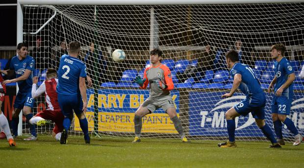 Fresh face: Teenage keeper Conor Byrne had to go between the sticks for the Swifts