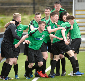 Out in front: Padraig Slane is mobbed after putting St Malachy's 2-1 ahead in extra-time
