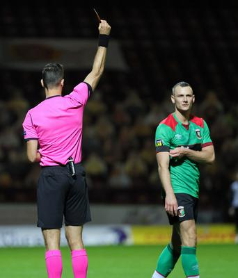 Off you go: Glens ace Seanan Clucas is dismissed after a second yellow card