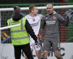 Boiling over: Rodney Brown (left) walks off with Ger Doherty after his controversial sending off at Glentoran