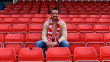 New colours: Josh Robinson is all smiles after joining Larne