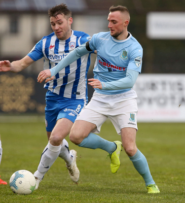 Battle stations: Ballymena United's Jude Winchester and Stephen Lowry of Coleraine clash on March 7, the last round of Premiership matches before football was suspended