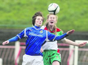 Glentoran's Catherine Sheridan with Linfield's Kirsty McGuinness