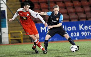 Fierce battle: Cliftonville's Joe Gormley takes on St Patrick's Athletic ace Conor Kenna in the Setanta Cup back in 2012