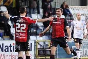 Easy street: Crusaders Philip Lowry celebrates his first goal with Paul Heatley