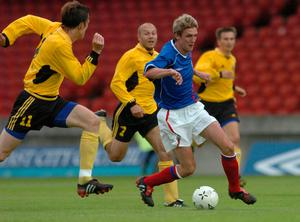 Andy Crawford in action for Linfield against HJK Helsinki in the Champions League in 2004