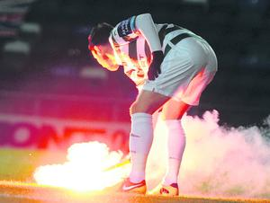 Missiles and flares were thrown on to the pitch last night