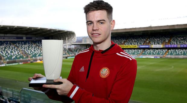 Top man: Portadown skipper Luke Wilson shows off his Championship Player of the Month prize