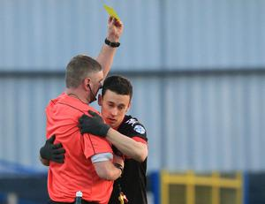 Raymond Crangle showing Crusaders winger Paul Heatley a yellow card