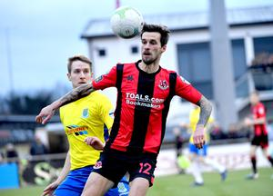 Only delayed: Crusaders ace Declan Caddell and Ballymena United's Jonny Addis set to clash at Seaview today