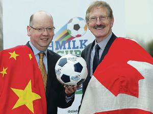 Dale Farm director Stephen Cameron (left) and Milk Cup chairman Victor Leonard after signing up China and Canada