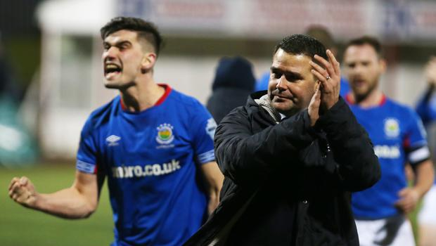 High point: David Healy and Jimmy Callacher (left) celebrate Linfield's big win over Cliftonville on Monday