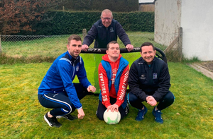 Having a ball: Newry fan Daniel Murphy gets a surprise visit from Decky Carville, Darren Mullan and (back) Sean Gaffney — 'Gaff' — one of the club's groundsmen