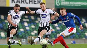 Joint approach: Linfield striker Shayne Lavery takes on Dundalk in the Unite the Union Cup match at Windsor Park in 2019