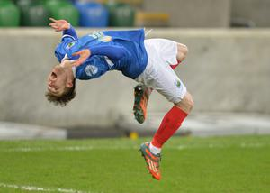 Linfield's Paul Smyth celebrates his strike in 6-0 win over Dungannon