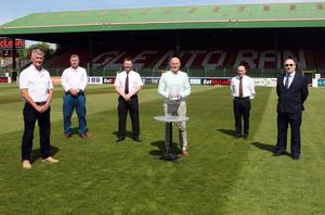 True legend: Roy Coyle is presented with the Ulster Footballer of the Year Dr Malcolm Brodie Lifetime Achievement Award alongside former goalkeeper Bobby Carlisle, Ken Moody, chairman of Ulster Footballer of the Year, Glentoran chairman Stephen Henderson, Jim Flanagan, vice-chairman Castlereagh Glentoran Supporters Club and Steven Brodie, son of the late Dr Malcolm Brodie