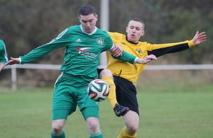 Tight call: Welders' Ryan Deans with Dundela's Stephen Gourley