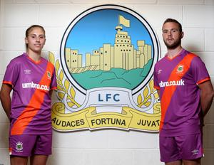 Kitted out: Linfield Ladies player Kelsie Burrows and club captain Jamie Mulgrew help launch the new Blues away kit at Windsor Park