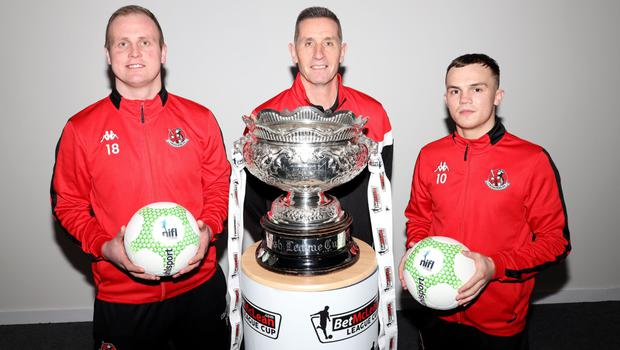Cup fever: Crusaders trio Jordan Owens, boss Stephen Baxter and Rory Hale get a close look at the League Cup