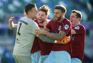 Final say: Ross Glendinning (left) celebrates with Josh Kelly, James Knowles, Steven McCullough and Andy McGrory