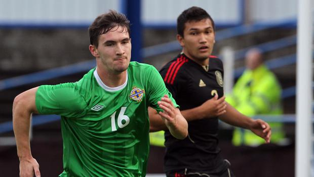 National duty: Michael McLellan takes on Mexico at the 2013 Milk Cup