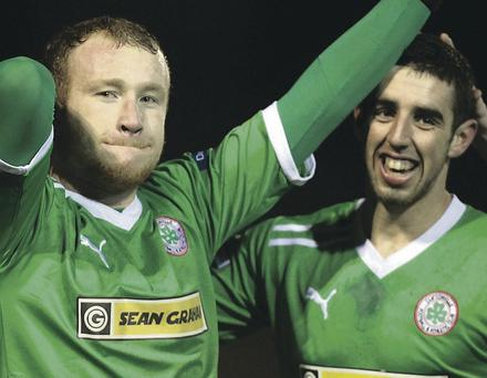 Cliftonville's goal heroes Liam Boyce (left) and Joe Gormley (right) celebrate at Clandeboye Park last night