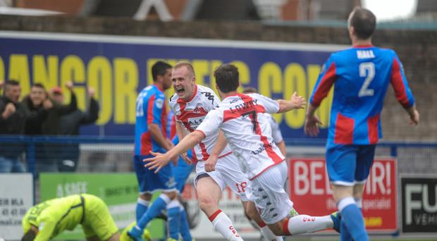 In the bag: Jordan Owens reacts after his late winner sunk Ards