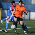 Jostle: Ards' Emmet Friars challenges James Gray