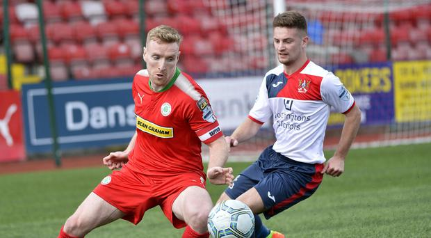 Tight watch: Kyle Cherry closes in on Cliftonville's Chris Curran