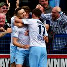 Centre stage: Shane McGinty celebrates Ballymena's winner