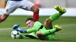 Safe hands: Sam Johnston claims control with Linfield's Andy Waterworth lurking