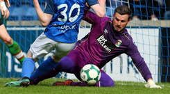 Taking charge: Elliott Morris ensures there's no way past for Glenavon's Jordan Jenkins