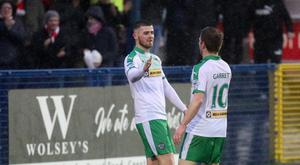 On course: Rory Donnelly and Stephen Garrett toast Cliftonville's opening goal