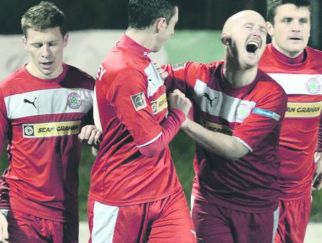 Ryan Catney sees the funny side as he celebrates with Joe Gormley who scored Cliftonville's third goal