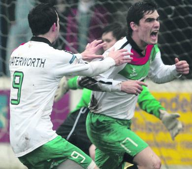 Cup joy: Jimmy Callacher celebrates scoring Glentoran's equalising goal on their way to Irish Cup victory over Bangor
