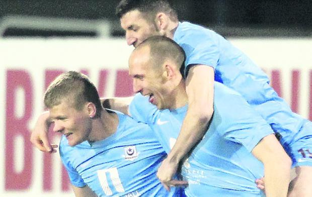 Drogheda's Alan Byrne is congratulated after opening the scoring at Shamrock Park