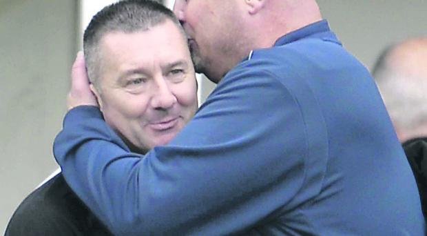 Linfield boss David Jeffrey gives Patterson his own special welcome.